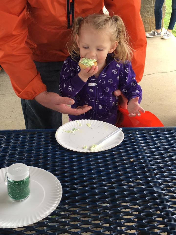 Girl eating frosted cookie