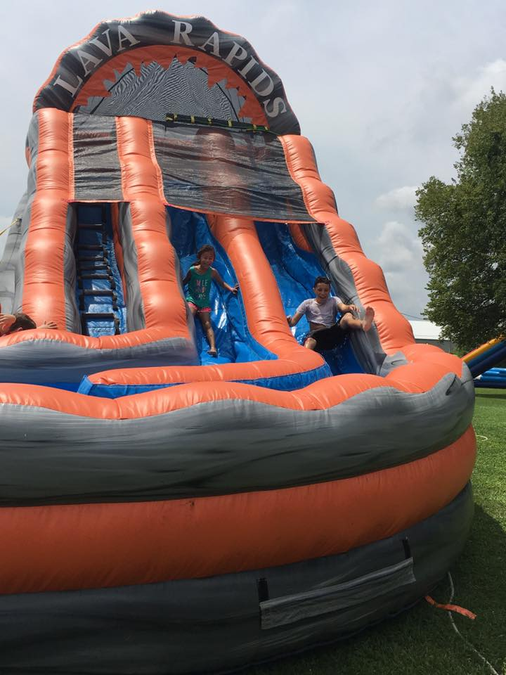 Kids on Inflatable Water Slide